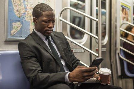 Handsome businessman in subway