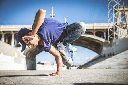 B-boy breakdancing outdoors