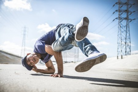 B-boy breakdancing outdoors