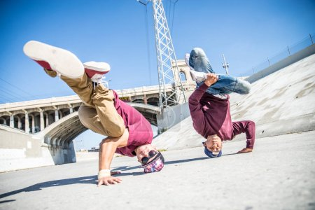 Break dancers performing tricks
