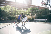 Basketball players training on court