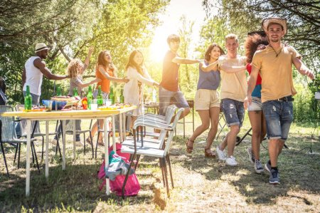 Friends partying at picnic