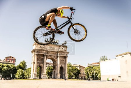 Athlete making tricks on bicycle