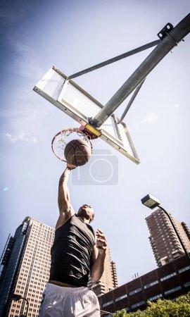 Basketball player making dunk