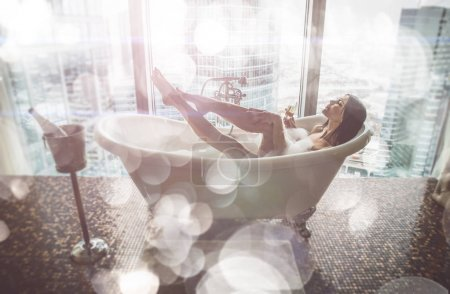 Seductive woman taking relaxing bath in her jacuzzi