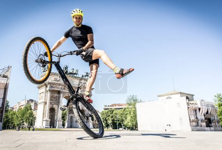 Young athlete making tricks on his bicycle