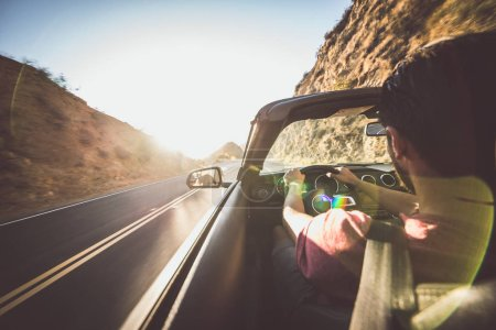 Man driving convertible car in Los angeles, santa monica