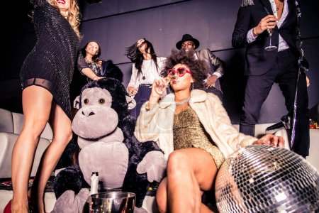 Friends having party in nightclub