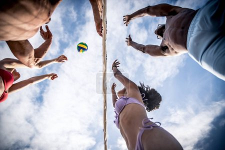 Friends playing beach volley