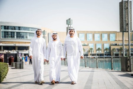 Arabian businessmen walking in Dubai