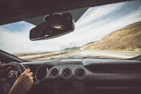 Photo for Man driving his sport car at sunny morning - Royalty Free Image