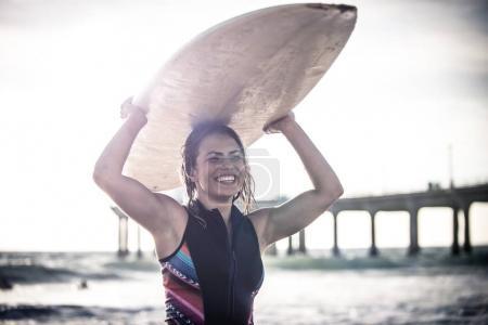 Surfer girl in water