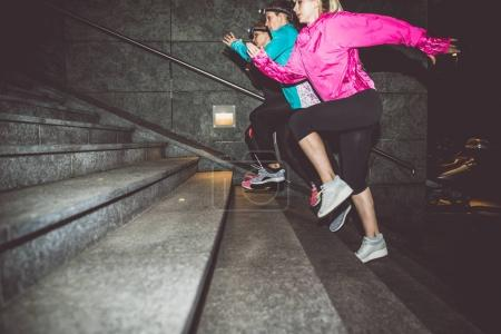 Women running in night