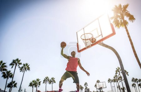 Basketball slam dunk on a californian court