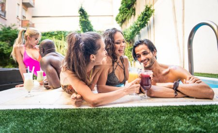 Friends having party in  swimming pool