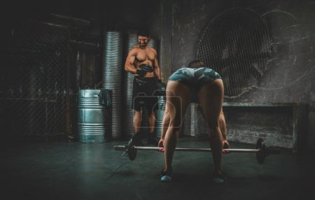 Photo for Young people making functional training in the grungy gym - Royalty Free Image