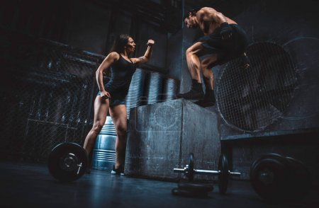 Young people making functional training in the grungy gym