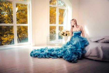 Beautiful woman with fancy wedding dress make preparations for t