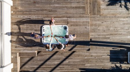 Photo for Group of friends having fun on a penthouse terrace, view from above - Royalty Free Image
