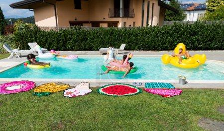 Friends having fun in a swimming pool