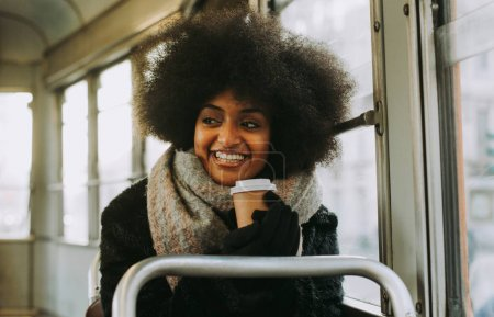Beautiful girl with afro haircut portraits in the public transpo
