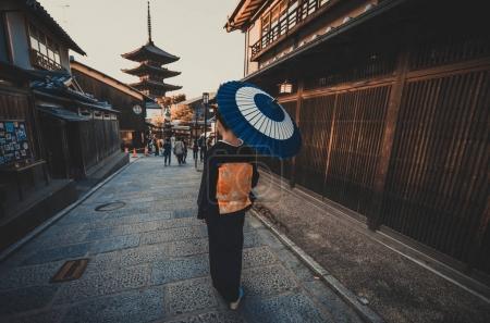 Beautiful japanese senior woman walking in the village. Typical