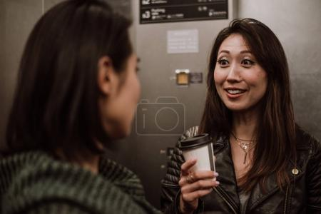 Two japanese women around in Tokyo during daytime. Making shoppi