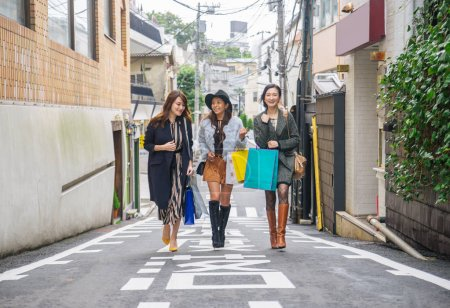 Photo for Three women doing shopping outdoors - Best friends meeting while shopping in Tokyo - Royalty Free Image