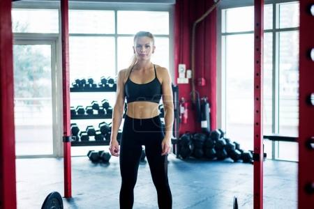 Photo for Muscular athlete training in a crossfit gym - Functional training workout in a gym - Royalty Free Image