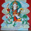 Sacred wall paintings with a Tibetan deity in a cr...