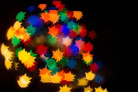 A festive kaleidoscope, a bright light and glare. Composition of