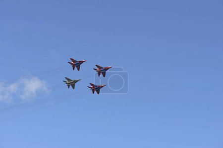 four combat fighter MiG-29 in the blue sky