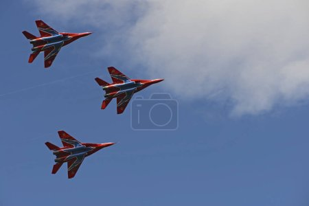 three combat fighter MiG-29 in the blue sky