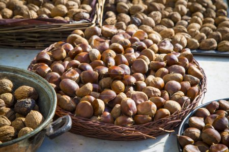 Photo for Background of many hazelnuts and walnuts in baskets,  healthy food - Royalty Free Image