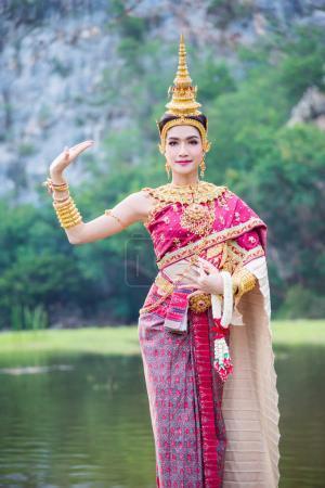 Beautiful asian woman wearing Thai ancient traditional costume dancing