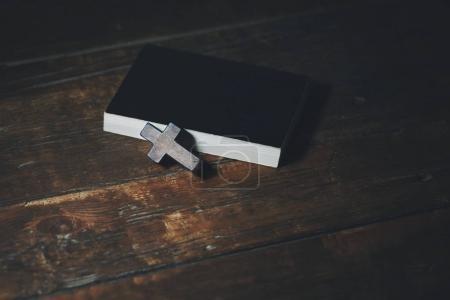 Cross on book