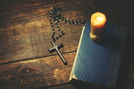 Photo for Cross, book and candle on wooden background - Royalty Free Image
