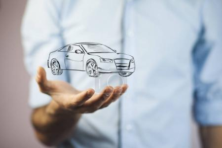 hand with car icon