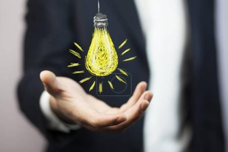bulb over  hand, Business idea