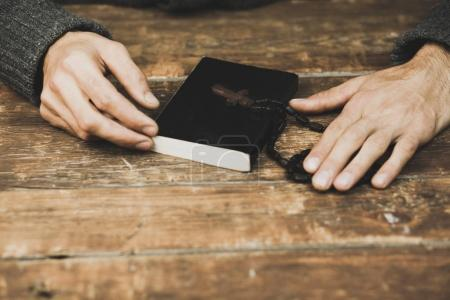 man with  cross and bible
