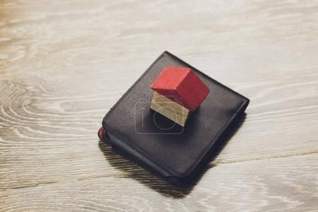 house on wallet on n table