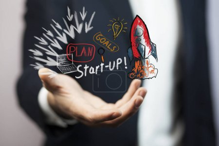 Businessman with  red rocket in his hand