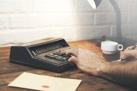 Business man using a calculator