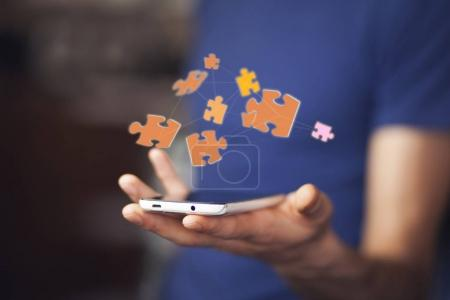 puzzle over smartphone on  hand