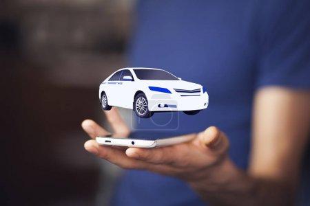 Businessman with  virtual car, close up