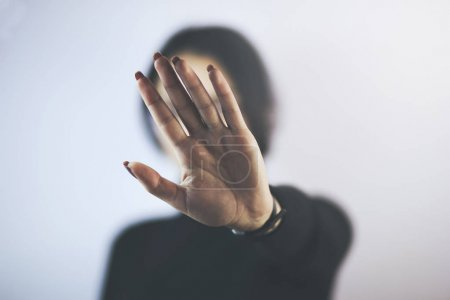 Young woman showing her denial with hand