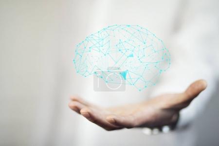 Photo pour Mâle main avec icône de cerveau. Cncept - image libre de droit