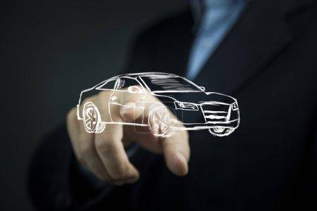 businessman touching car in screen