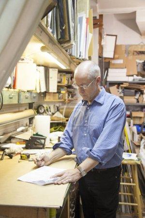 Frame shop owner