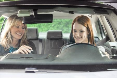 Photo for Teenager in car with driving instructor - Royalty Free Image